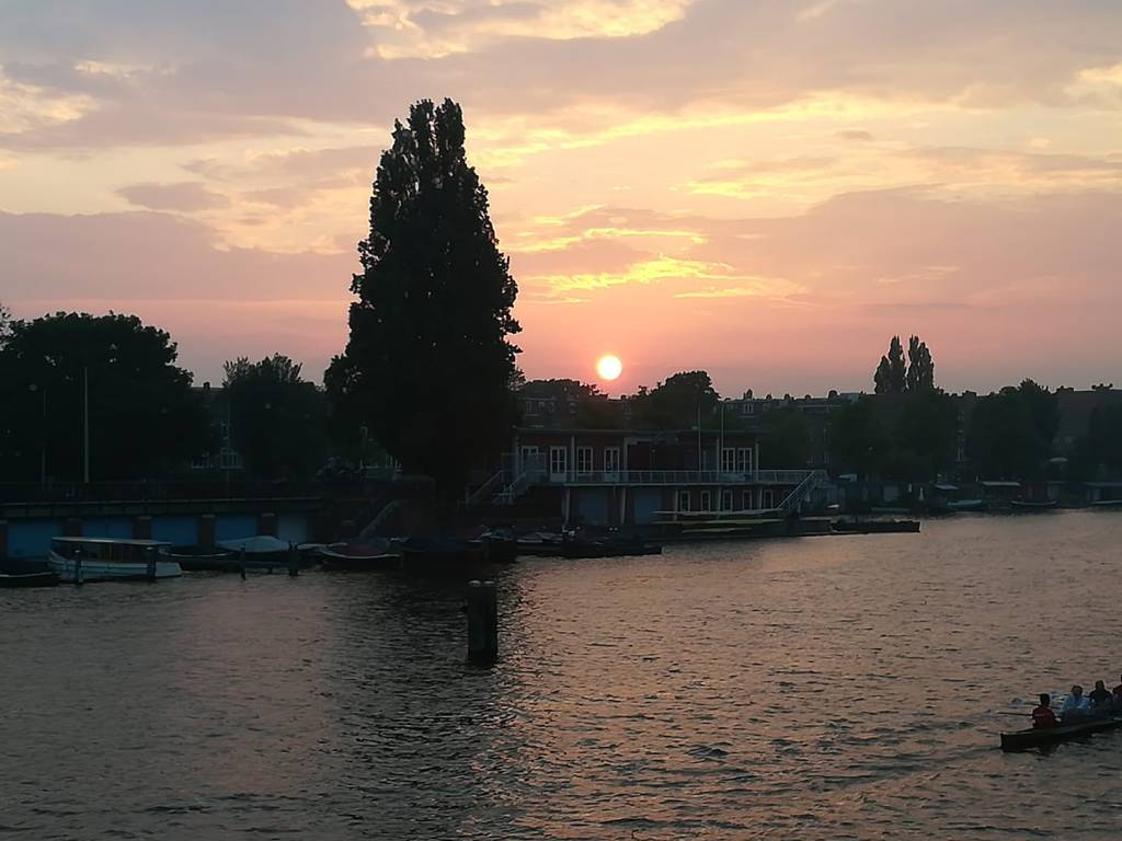 Sunset over the Amsteldijk in Amsterdam, North Holland, The Netherlands.